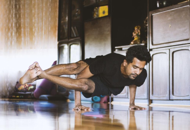 man doing handstand pose
